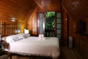 A bed or beds in a room at Cabana da Imperatriz
