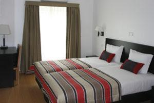 A bed or beds in a room at Hotel A Esteva