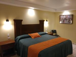A bed or beds in a room at Hotel Marques de Cima