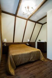 Кровать или кровати в номере Парк-Отель Дубрава