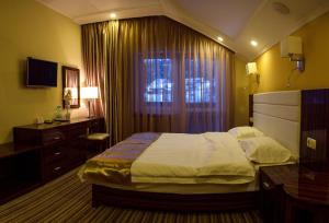 A bed or beds in a room at Fortuna