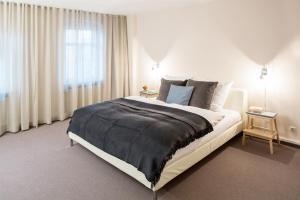 Ein Bett oder Betten in einem Zimmer der Unterkunft Hotel Anna