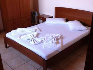 Кровать или кровати в номере Taxiarchis
