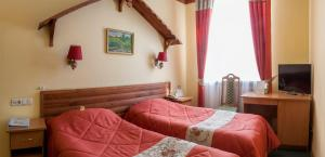 A bed or beds in a room at Snegurochka Hotel