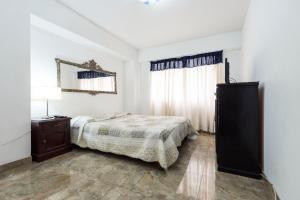 A bed or beds in a room at Apartamento Edificio Pardo Cinco