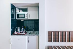 A kitchen or kitchenette at Muthu Raga Madeira Hotel