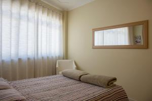 A bed or beds in a room at Flat General