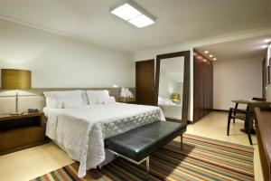 A bed or beds in a room at Sia Park Executive Hotel
