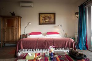 A bed or beds in a room at Hostería Chacra Bliss