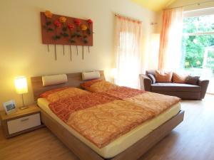 Ein Bett oder Betten in einem Zimmer der Unterkunft Badische Landoase