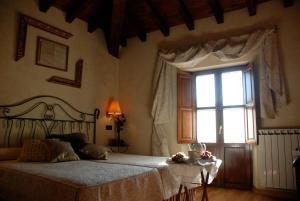 Cama o camas de una habitación en Posada Rural Fontibre