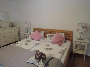 Ein Bett oder Betten in einem Zimmer der Unterkunft Landhaus Aigner