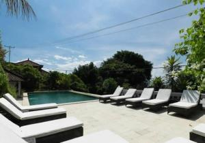 The swimming pool at or near Baliku Dive Resort