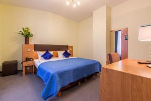 Кровать или кровати в номере Hotel Expo Frankfurt City Centre