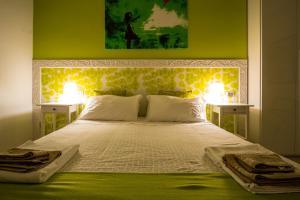 Letto o letti in una camera di B&B DormiRe Bologna
