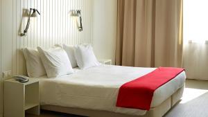 Cama o camas de una habitación en Hotel Flor De Sal