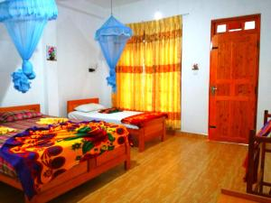 A bed or beds in a room at Pearl View Guesthouse