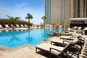 The swimming pool at or near Sofitel Abu Dhabi Corniche