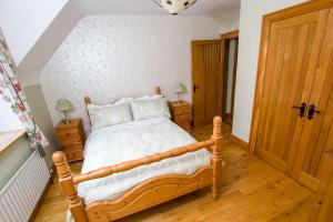 A bed or beds in a room at Erne Valley B&B