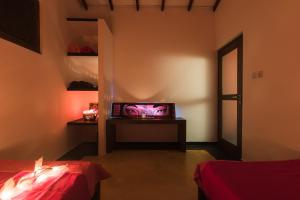 A television and/or entertainment centre at Your Dream Home - Mirissa