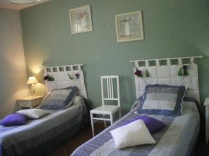 Un ou plusieurs lits dans un hébergement de l'établissement Chambres d'hôtes Boudeau