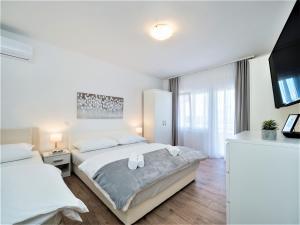 Posteľ alebo postele v izbe v ubytovaní The Majestic VIEW