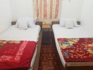 A bed or beds in a room at Pann Myo Thu Inn