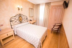 Кровать или кровати в номере Hotel Julia