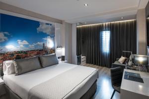 Catalonia Gran Via BCN tesisinde bir odada yatak veya yataklar
