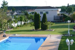 A view of the pool at Villamercedes 1 or nearby