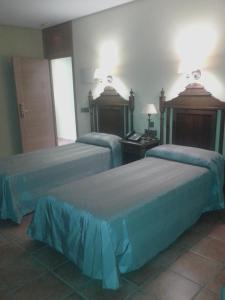 Cama o camas de una habitación en Hospedería Santuario Virgen de la Cabeza