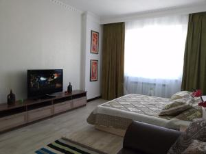 A television and/or entertainment centre at Apartment Finika3 in the Center