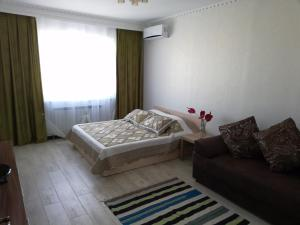 A bed or beds in a room at Apartment Finika3 in the Center