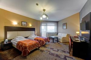 Łóżko lub łóżka w pokoju w obiekcie Hotel i Restauracja Bona