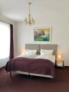 Hotel Sylter Blaumuschelにあるベッド