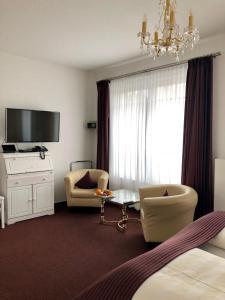 Hotel Sylter Blaumuschelにあるテレビまたはエンターテインメントセンター
