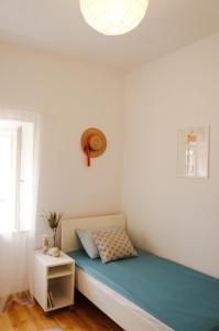 Postel nebo postele na pokoji v ubytování Nona Nata's House