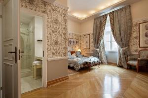 Posteľ alebo postele v izbe v ubytovaní Bonerowski Palace