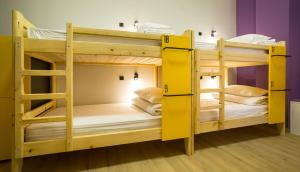 A bunk bed or bunk beds in a room at HOTEL Bee Station