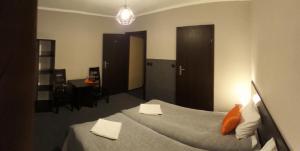 Łóżko lub łóżka w pokoju w obiekcie Pokoje gościnne Winnica Celtica