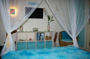 Un ou plusieurs lits dans un hébergement de l'établissement LeLagon Vue Mer, Pieds dans l'eau