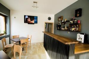 The lounge or bar area at Penzion Na Americe