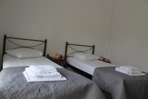 A bed or beds in a room at Dimitriadis Hotel