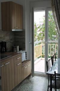 A kitchen or kitchenette at Dimitriadis Hotel