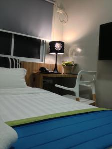 A bed or beds in a room at Z Pad Residences