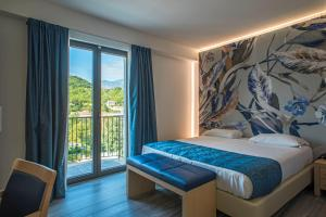 A bed or beds in a room at Hotel Terme Capasso