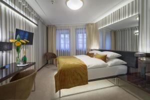 A bed or beds in a room at Clementin