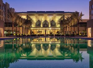The swimming pool at or near Kempinski Hotel Muscat