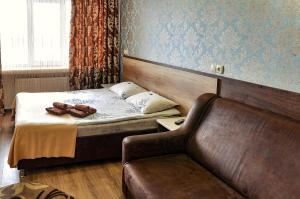 A bed or beds in a room at Nirvana