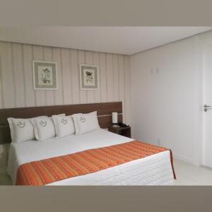 A bed or beds in a room at Pousada Gaia